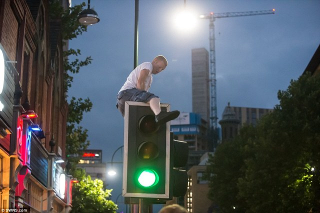 Unable to celebrate, revellers in Birmingham simply took to the streets and instead climbed traffic lights in protest