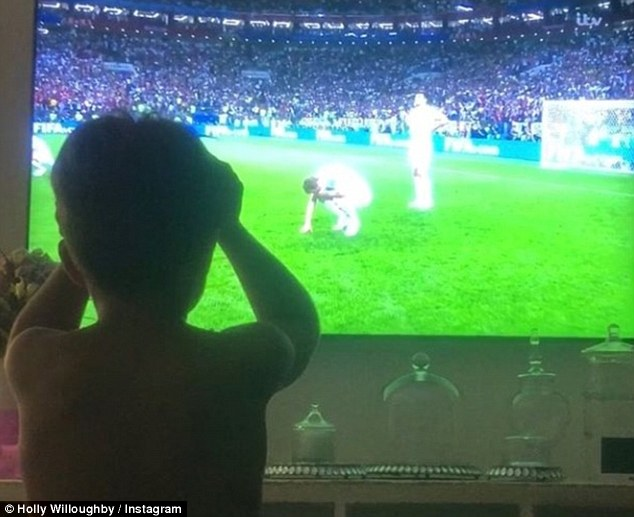 Heartbroken: Meanwhile, Holly also posted a picture of her her son, Harry, nine, as he watched the end of the match with a friend, with his head in his hands