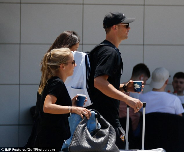 Neuer and his wife were spotted carrying luggage to their hotel after arriving in Ibiza