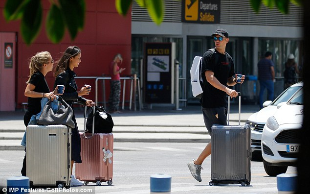 Manuel Neuer (R) arrives in Ibiza with his wife, Nina Weiss (L), after World Cup heartbreak
