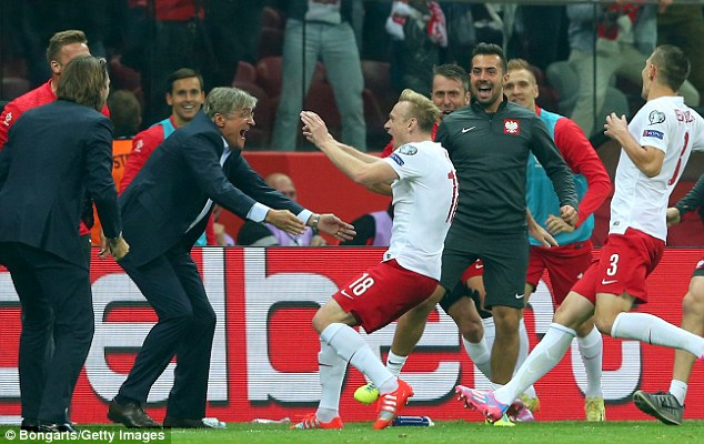 Adam Nawalka (centre left) guided Poland to the Euro 2016 quarter-finals, losing to Portugal