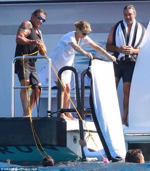 Great time:They are reclining in true movie style fashion on a yacht off the coast of St Tropez