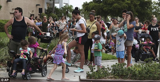 Build-A-Bear stores across North America and the United Kingdom were forced to closed for the day on Thursday after an advertising stunt received an overwhelming response; Parents and children are seen here waiting in line for close to an hour at Coral Square mall in Coral Springs, Florida, for the Build-A-Bear Workshop Pay Your Age day event on Thursday