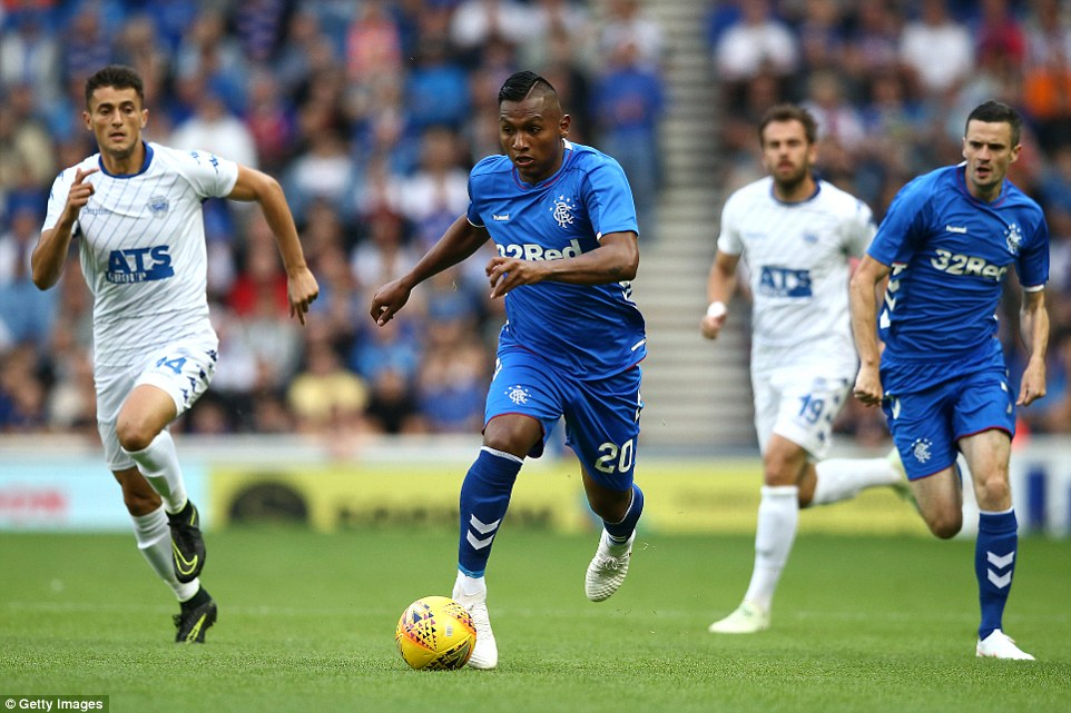 Alfredo Morelos (centre) of Rangers breaks away from Toni Tipuric (left) of Shkupi during the first half of Thursday's clash