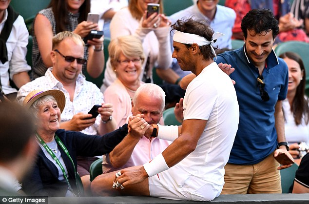 Rafael Nadal apologises after falling on to a woman during his win overJuan Martin Del Potro