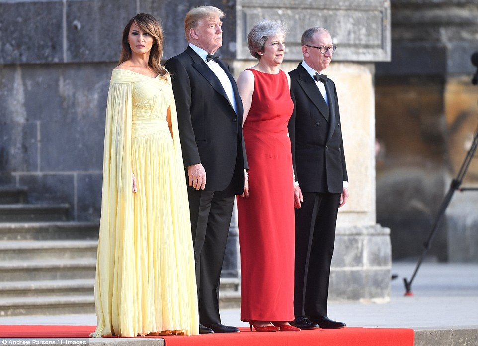 President Trump's wife Melania worea floor-length, pleated buttercup yellow gown for her first visit to Britain as First Lady