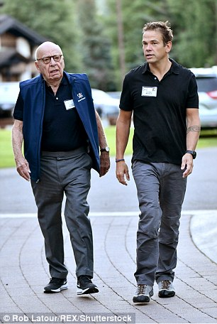 Family ties:Rupert and Lachlan Murdoch were seen heading to a session at the Allen & Co conference early Thursday morning (above)