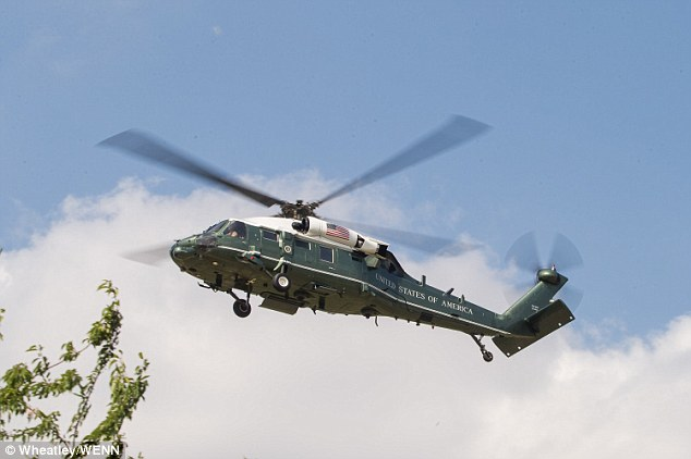 Marine One, the President's helicopter, is one of a large number of aircraft he has brought with him for the British visit (shown here landing with him inside)