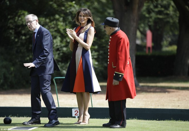 Melania, elegant in a £1,550 Victoria Beckham dress, threw herself into the spirit of the competition and clapped and cheered