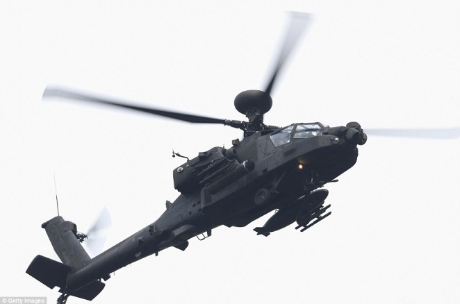 A British army Apache helicopter hovers as President Donald Trump arrives at Sandhurst Miltary Academy