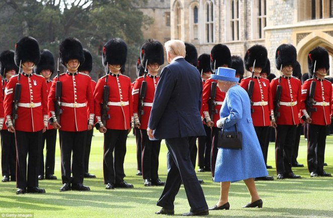 Donald Trump and the Queen inspect the Guards in the grounds, where the president was treated to a performance of the US national anthem