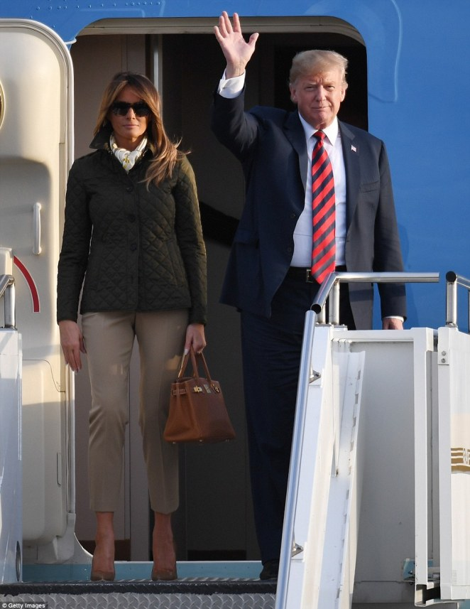Thrice as nice! Melania Trump showed off her third outfit of the day as she landed in Scotland with her husband Donald