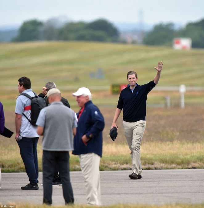 Eric Trump wearing chino's, dark blue polo shirt will spend the weekend at Turnberry schmoozing with business contacts fl