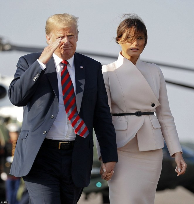 Fashion-forward: Melania arrived at Stansted in the same pale suit she had worn to meet the Queen, however she then changed her outfit once on-board