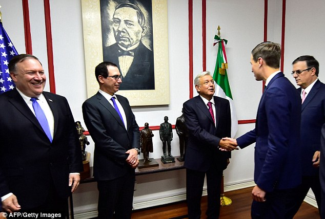 Big moment: OMLA shook hands with Jared while the newly appointed Secretary of Foreign Affairs Marcelo Ebrard (right) looked