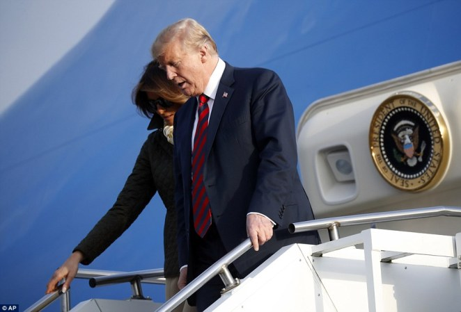 President Donald Trump and first lady Melania Trump descend the stairs of Air Force One at Glasgow Prestwick Airport in Scotland