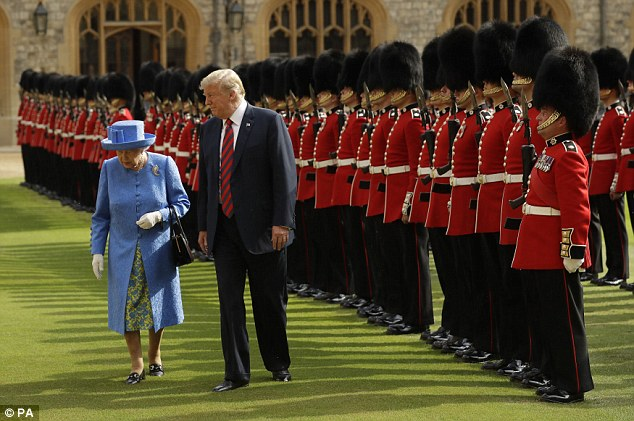 US President Donald Trump and Queen Elizabeth II inspect a Guard of Honour