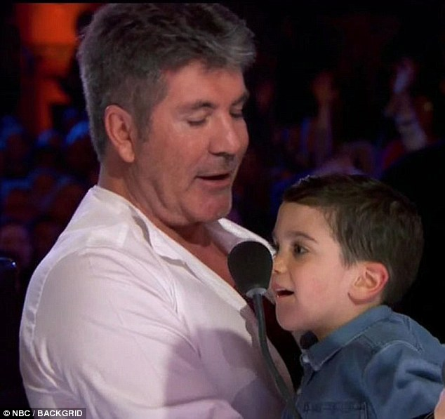 Doting dad: Simon Cowell has spoken out about his love of being a father to his four-year-old son Eric  as he admitted he has no plans to have anymore the children