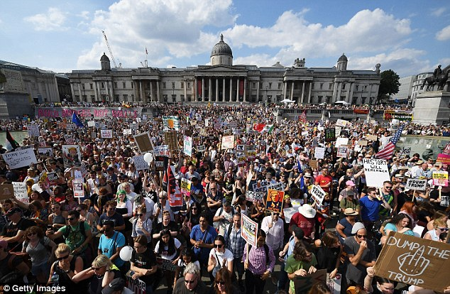'Dump the Trump!' Trafalgar Square entirely filled with demonstrators as police urge people to stay away as the area is at full capacity