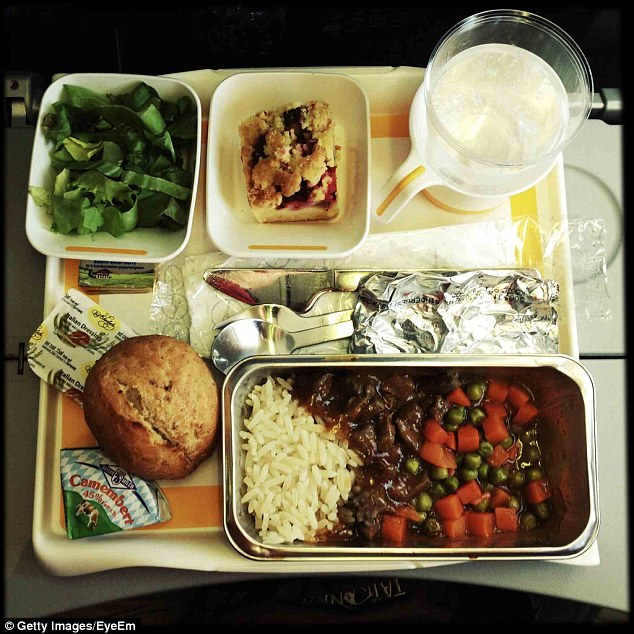 Both before you board, and once you get on the plane, you should limit salty foods and bread rolls, instead opting for protein-rich options like crackers and cheese (stock image)