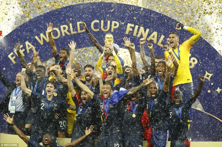 Hugo Lloris (centre) lifts the World Cup aloft as France were crowned champions after beating Croatia 4-2 on Sunday