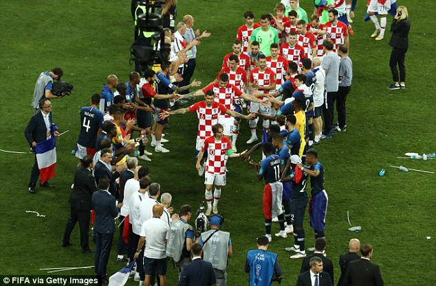 France players give Croatia a guard of honour as they go to recieve their runners-up medals