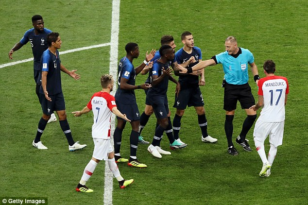 France players confront referee Nestor Pinata after Perisic handled the ball inside the box