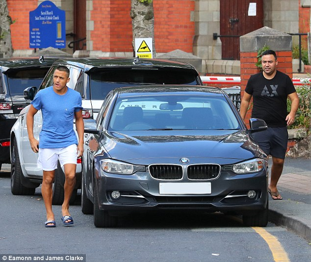 Former Arsenal star Sanchez wore a blue T-shirt and white shorts as he sported a shaved head