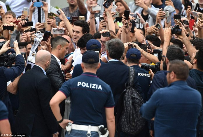 Ronaldo stopped to sign autographs for some of the waiting supporters as he made his way into the building