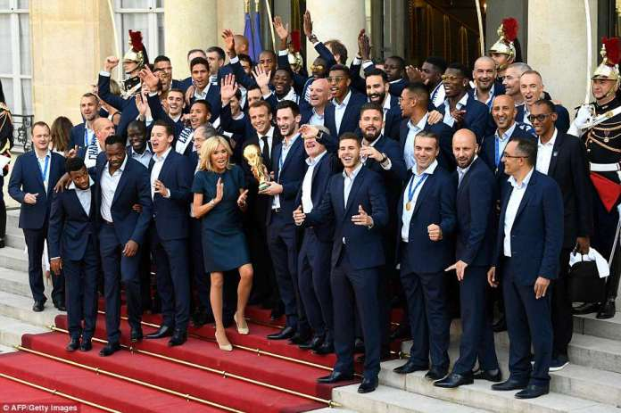 The team looked in high spirits as they posted with Brigitte and Emmanuel Macro on the steps of the Elysee Presidential Palace