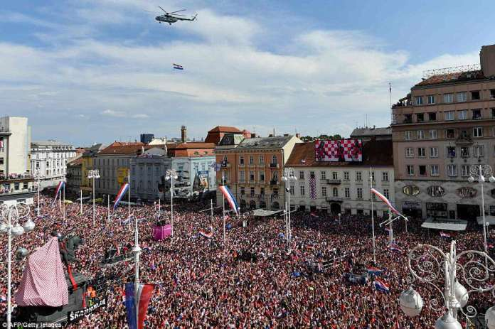 A Croatian Air Force helicopter above the crowds flew the nation's flag over the square