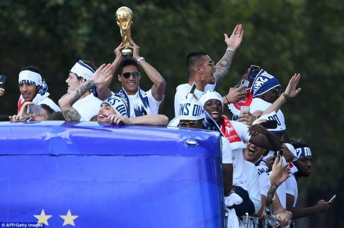 Defender Raphael Varane could not contain his excitement as he partied with his teammates on the bus