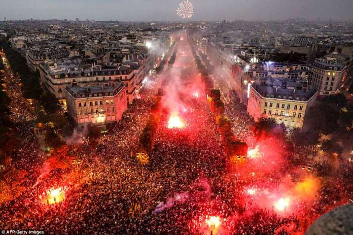 People wrapped in flags arched down the avenue where France displayed its military might a day earlier for Bastille Day