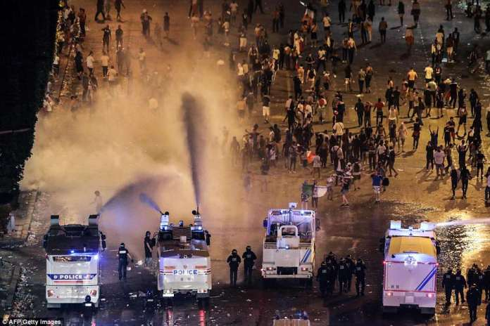 Even before the final whistle in Moscow, crowds packed the Champs Elysees in central Paris in a repeat of the scenes of 1998. Pictured: Water cannons are used to clear revellers from the Avenue