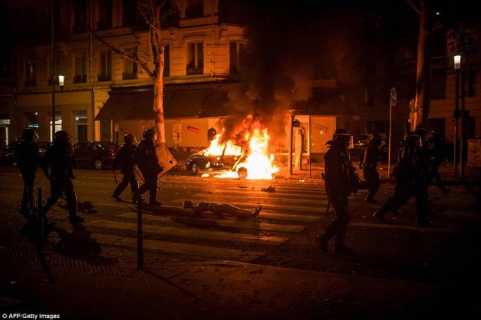 A car was torched as rioters went on the rampage in the French city of Lyon after the country's World Cup triumph yesterday