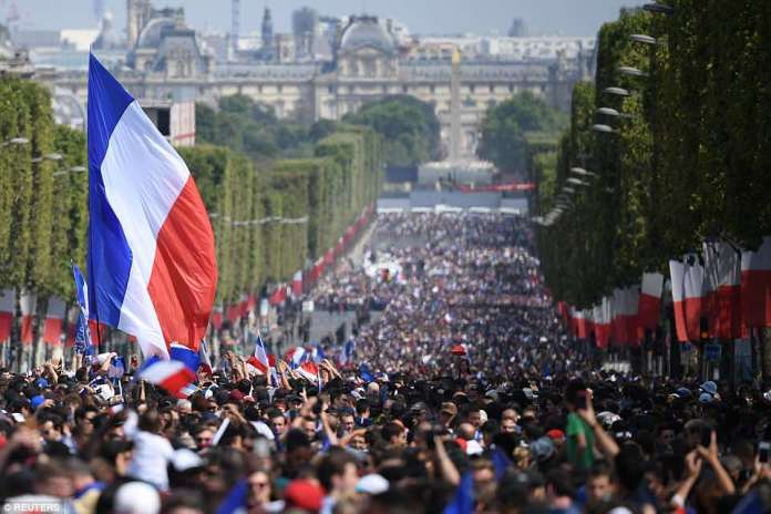 Thousands of French people take to the streets of Paris to celebrate their football team's success in the World Cup in Moscow