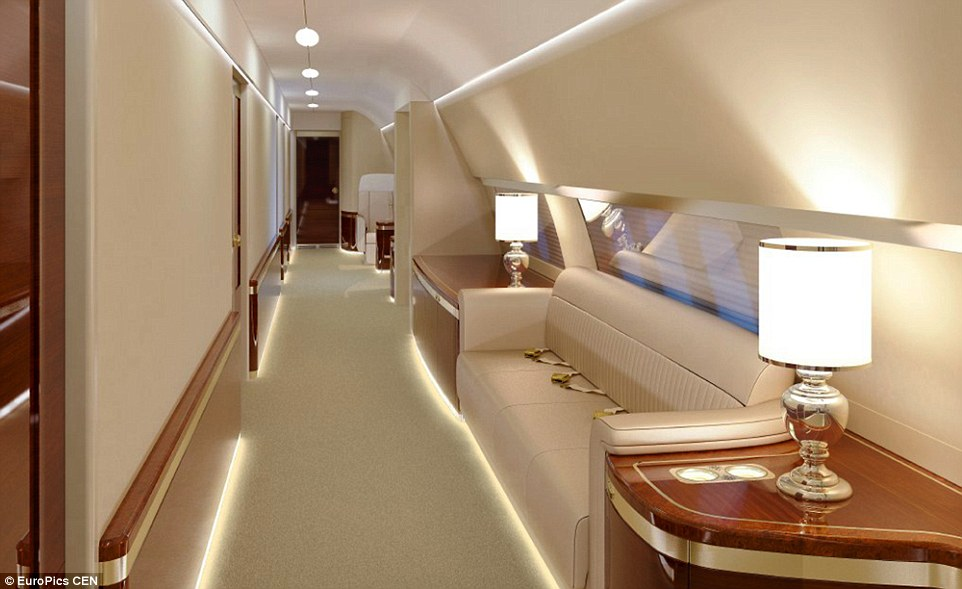 One of the long corridors on the aircraft, which again is finished in a gold trim, has a large sofa for relaxing