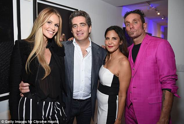 All over now: Elle (second from left), pictured with former flame billionaire Jeffrey Soffer on December 3, 2014