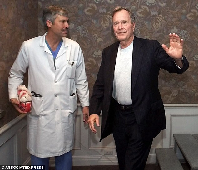 Dr Mark Hausknecht (left) was killed Friday while riding his bike in Texas. He has treated former president George H W Bush in 2000