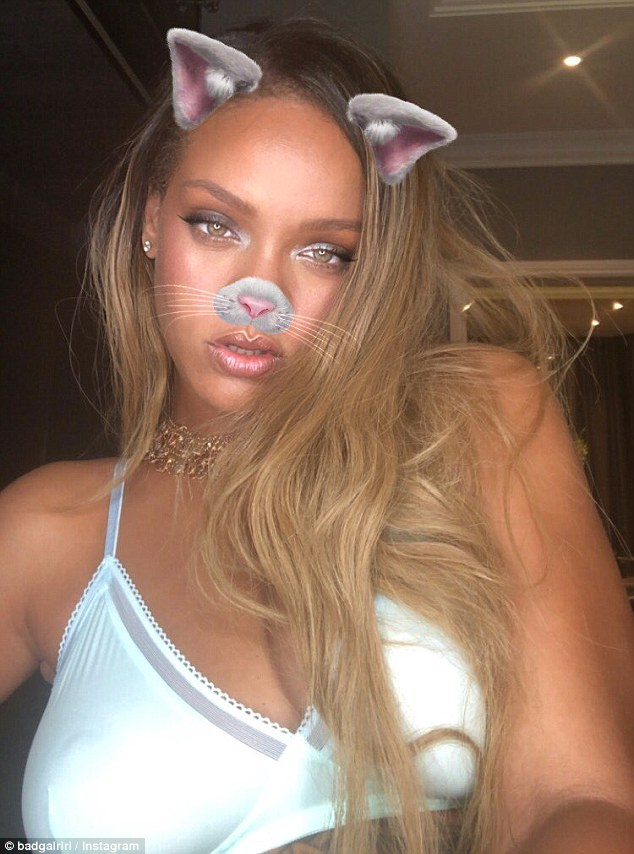 Having fun: Rihanna posted an Instagram story on Saturday in which she was seen shaking her boobs in a white, barely-there bra