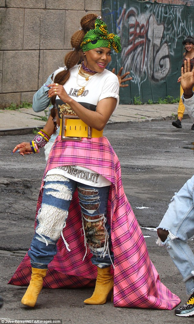 Eye-catching: The hitmaker completed the ensemble with a pink plaid half skirt fastened at the waist with an oversized yellow belt with huge silver buckle