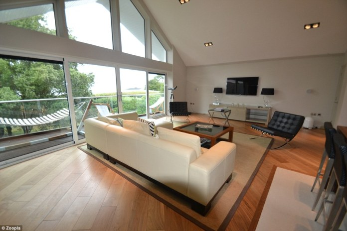 The focal point of this outstanding property is undoubtedly the lofty open plan living space