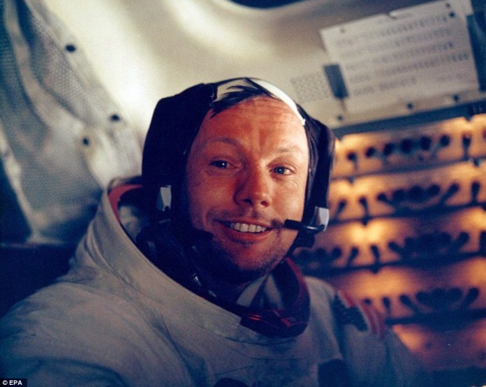 A file handout photo dated 20 July 1969 provided by NASA shows Apollo 11 astronaut Neil Armstrong inside the lunar module after his historic walk on the surface of the moon.