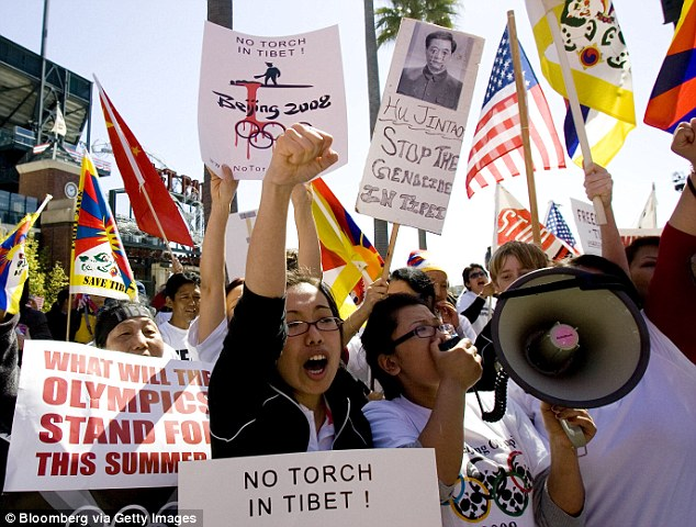 Tibetan activists protest before the 2008 Beijing Olympic torch relay in San Francisco, California, on April 9. China was accused of forcing students from around the California area to descend on the city for counter-protests