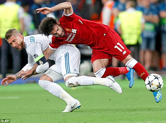 Sergio Ramos hauled Mo Salah to the ground, a challenge that injured the Liverpool forward