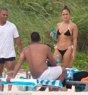 Beach babe: Jennifer Lopez flaunts abs in the Bahamas