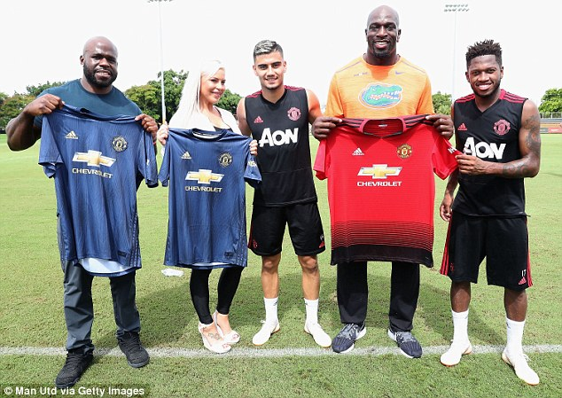 The WWE athletes towered over the players as they posed with the new United shirts
