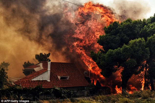 Flames threaten to engulf a house in Kineta, near Athens, last week. Insurer Hiscox, which covers wealthy clients worldwide, is braced for an influx of claims after the disaster