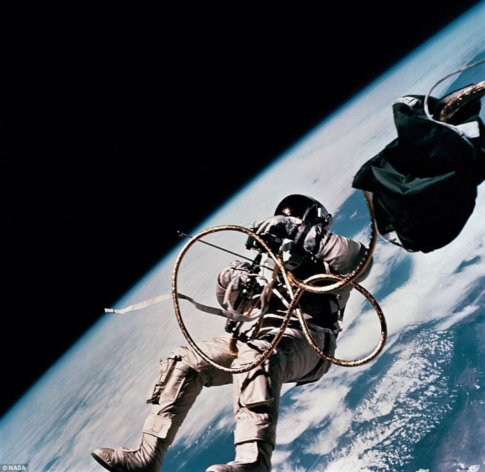Astronaut Ed White, pilot for the Gemini-Titan 4 (GT-4) spaceflight, floats in the zero-gravity of space during the third revolution of the GT-4 spacecraft. His face is covered by a shaded visor to protect him from the unfiltered rays of the sun. He remained outside the spacecraft for 21 minutes during the third revolution of the Gemini 4 mission. In his right hand, he carries a Hand-Held Self-Maneuvering Unit (HHSMU) with which he controlled his movements while in space. He was attached to the spacecraft by a 25-feet umbilical line and a 23-feet tether line, both wrapped together with gold tape to form one cord. He also wears an emergency oxygen supply chest pack..jpg