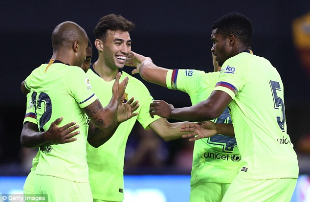 Rafinha celebrates with his team-mates after giving Ernesto Valverde's side an early lead